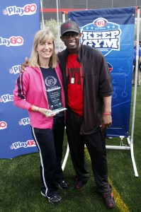 PE Teacher of the Year Dana Griffith with Deion Sanders  (Jason DeCrow/AP Images for NFL Network)