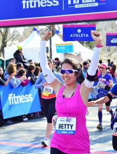 Betty Wong crosses the finish line at the More/FITNESS Women's Half Marathon.