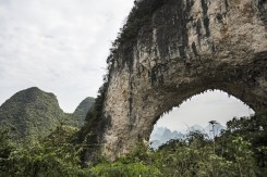 Can you spot Paige climbing on the famous Moon Hill arch in China?