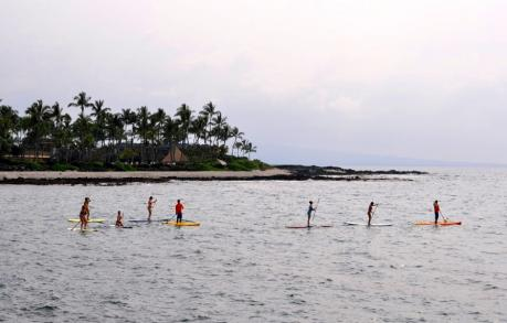 Paddleboarding off the coast of Hawaii's Big Island (That's me, third from the right)