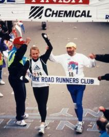 Grete crosses the finish line at the 1992 New York City Marathon with New York Road Runners founder Fred Lebow as he battled cancer. (Photo courtesy of Victah