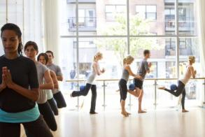 Sadie helps attendees achieve proper alignment in her stunning studio. (Photo courtesy of Barre3)
