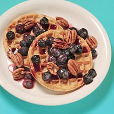 Whole-wheat waffles with fruit and nuts or nut butter are a perfect energy-boosting breakfast. (Photo by Chris Gallo)