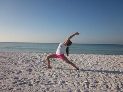 christie griffin warrior 1 sun salutation at inn at crystal beach on emerald coast in florida