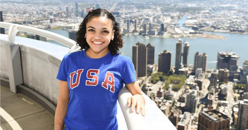laurie hernandez s first pitch at a pro baseball game shows her