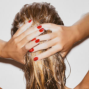 Back of woman washing hair