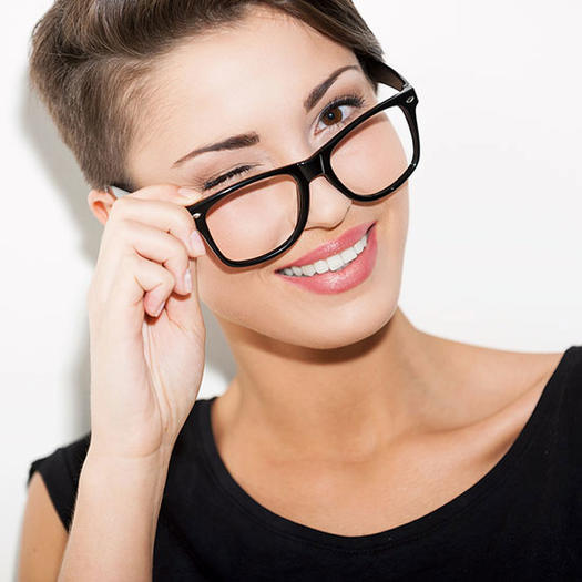 Woman winking, woman wearing glasses