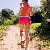 Woman running up trails