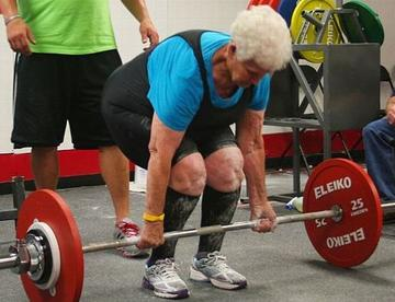 old woman deadlifts heavy weight  fitness magazine